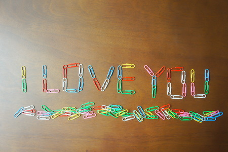 Paperclip with front i love you on wood texture