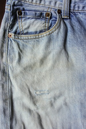 Detail of nice blue jeans in vintage style
