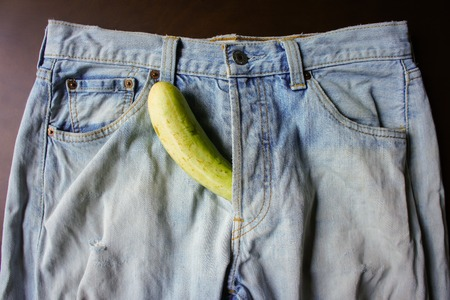 cucumber is the mark of penis in Jeans Stock Photo