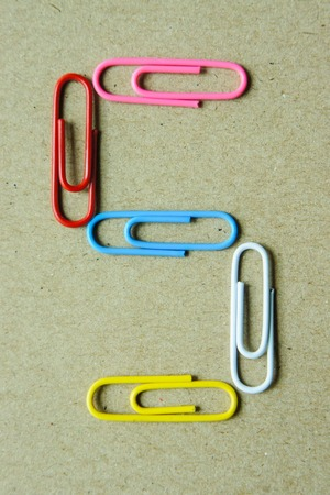 Number five of paper clip on brown paper background