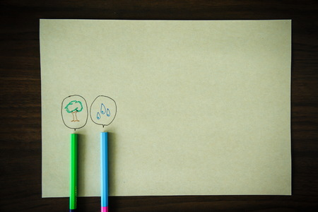 pencil with a speech bubble isolated on brown paper background Stock Photo