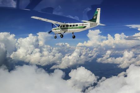 cessna: RAYONG , THAILAND- MAY 16 2015: Cessna 208 Caravan no.1918 of KASET , Bureau of Royal Rainmaking and Agricultural Aviation. U-TAPAO Airport, Rayong