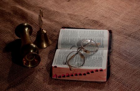 Afrikaans bible with reading glasses at candlelight photo