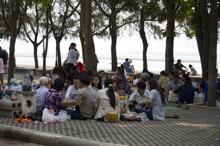 Large family seated in Thailand Editorial