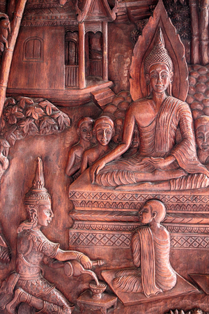 Buddha image carved on a wooden temple in Thailand. Stock Photo