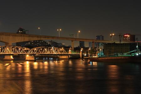 bangkok Bridge at night in Bangkok city, This bridge connect Bangkok side and Thonburi side,Thailand on April 10, 2011 Editorial