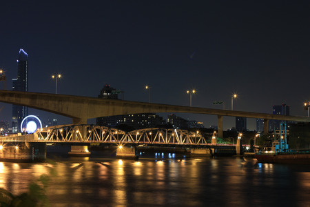 bangkok Bridge at night in Bangkok city, This bridge connect Bangkok side and Thonburi side,Thailand on April 10, 2011 Stock Photo