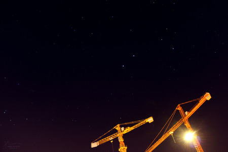 starry night: Yellow construction crane on starry night Stock Photo
