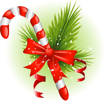 candy stick: Christmas candy cane decorated with pine branches and a bow. Over white.