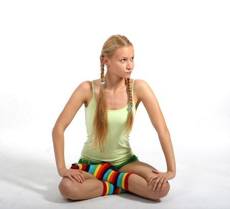 sceptical: Young attractive woman with sceptical look sitting in yoga pose
