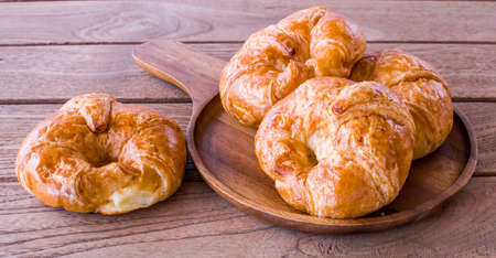 Freshly croissant on wooden background. It is a type of French pastry suitable as breakfast. It can be purchased at bakery worldwide.