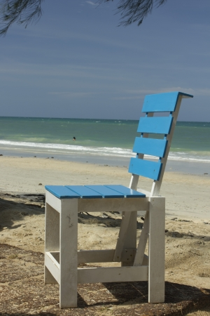 Blue wooden chair isolated over white