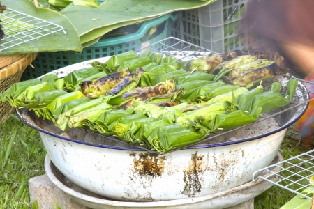 After baking is native Thailand  Wrapped in banana leaves  Put rice and bananas cooked inside  Stock Photo