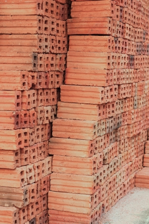 bricks used in the construction are made of earth, water, fire and burned up with the heat