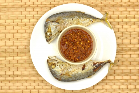 Fried fish with chili sauce and vegetables. Is the national dish. Thailands rural New York dining.