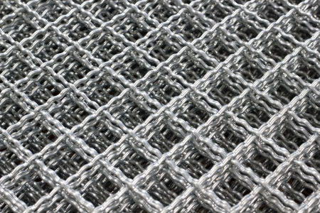 fabricate: Metal is used to fabricate thin knit a square. Protection of animals used for leak Stock Photo