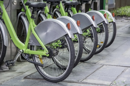 stumble: Urban bicycle rental service provided by the state to the general public. Stock Photo