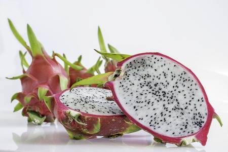 black seeds: Dragon fruit red fruit with black seeds inside, taste delicious, widely cultivated in Thailand