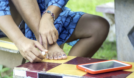 Woman painting nails with beautiful women. All countries in the world beauty