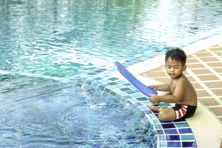 A boy preparing to swim  boy in water pool Childrens zone for swimming