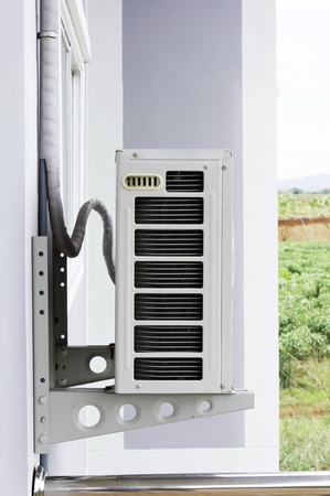 Home air conditioner In Asia, many Because hot air hanging on tall buildings Stock Photo