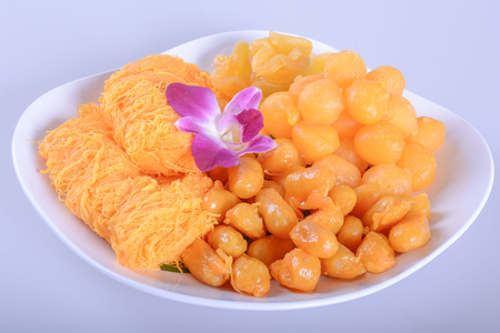 pinched: ancient Thai Dessert, thai sweet dessert,egg yoke fudge balls cooked in syrup, Pinched gold egg yolks, appetizer