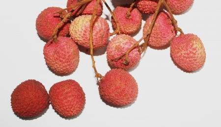 Fresh lychees on white