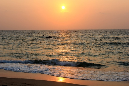 sunrise with wave on beach photo
