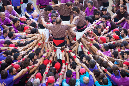 TARRAGONA, SPAIN - OCTOBER 6: Collas different members involved to form a castle with