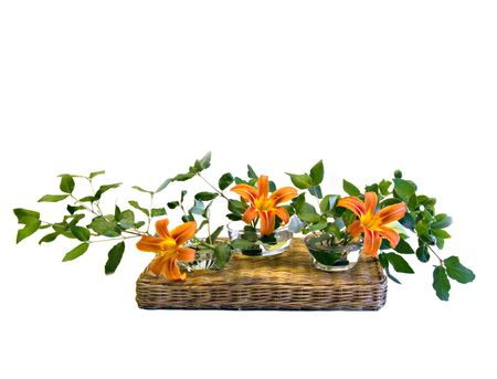 An ikebana arrangement of orange day lilies.