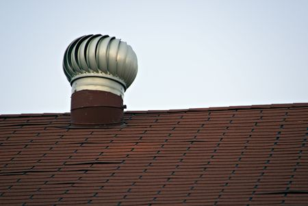 Roof top vent on a  dwelling in the city.  Reklamní fotografie