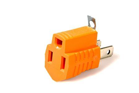 riek: Een drie spoor-plug adapter voor veiligheid stekkers. Stockfoto