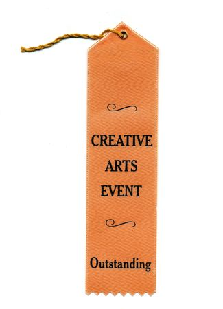 A peach colored award ribbon for outstanding.