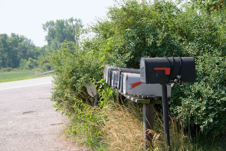 a rural community: A row of mail boxes in a rural community.
