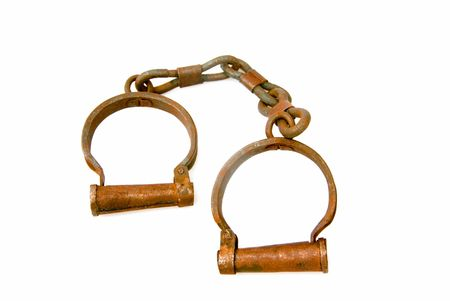 A pair of old and rusted vintage handcuffs.