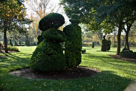 A garden of plantings shaped as human and object figures. Stock Photo