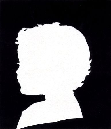 65 years old: A vintage cut paper portrait. Approximately 65 years old.