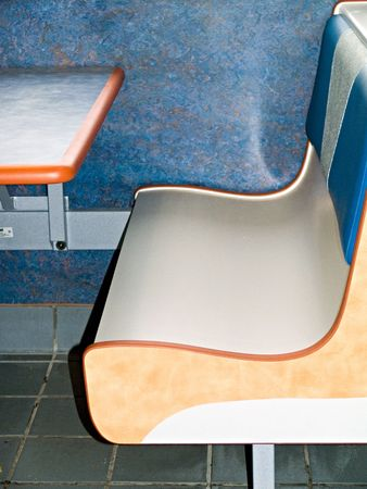 lounge: Corner of a table and bench in a fast food resturant. Stock Photo