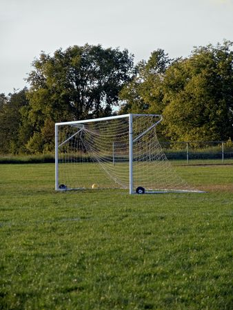 A soccer field and net in a small village.