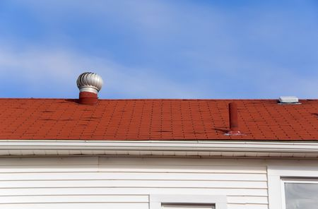 A roof top in a large city againes a blue sky. Stock Photo - 5932820
