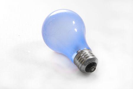 A blue light bulb on a white background.