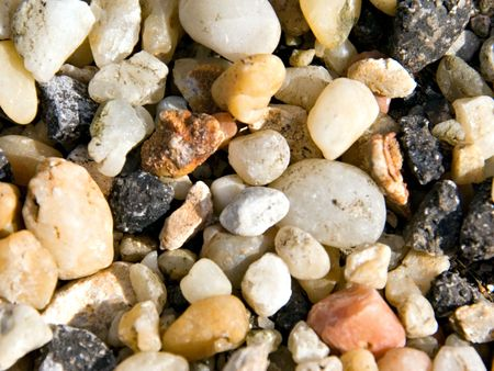 A collection of assorted pebbles in different colors, shapes and textures.