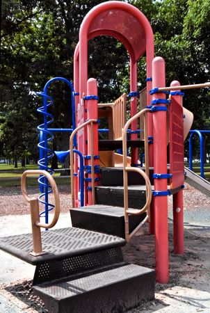 A set of play ground objects in a busy local park.