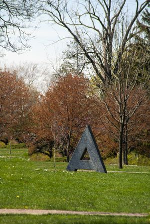 A letter as a statue in a childs area of a metropolitan park. Stock Photo - 7647539