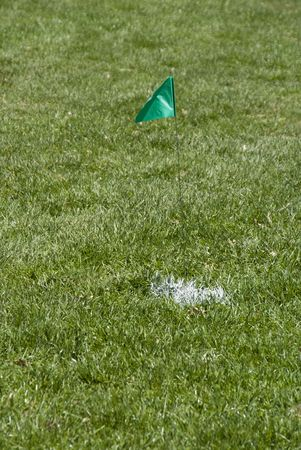 A green flag marking a crucial spot for maintenance or construction.