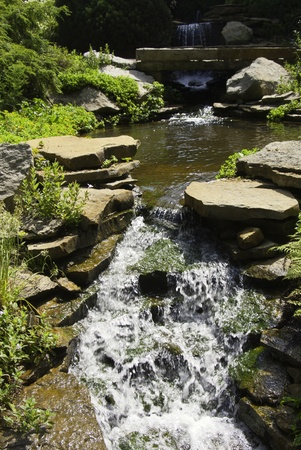 A view of a stream and waterfall in the country side. Stock Photo - 8422368