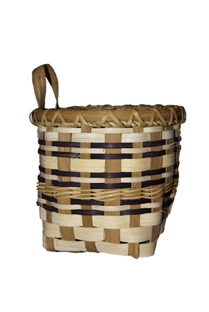 A medium sized basket that has been crafted by hand.