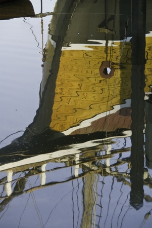 Reflection of a ship showing the shapes and ropes and rigging.  Stok Fotoğraf
