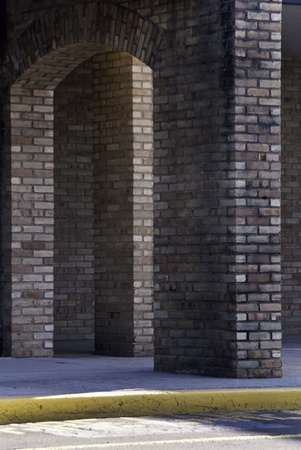 highlight: Brick columns in highlight and shadow.