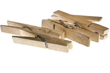 Severan wooden clothes pins with spring latches.